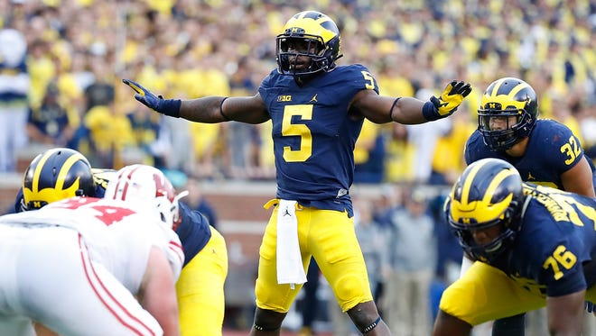 Jabrill Peppers #5 of the Michigan Wolverines lines up at quarterback during the third quarter of the game against the Wisconsin Badgers at Michigan Stadium on October 1, 2016 in Ann Arbor, Michigan.