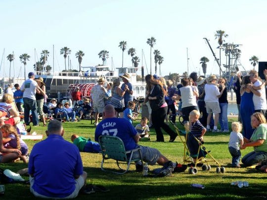 People dance to the music of Masters of the Past at Peninsula Park at Channel Islands Harbor, August 2016. The free 'Concerts by the Sea' take place every Saturday.