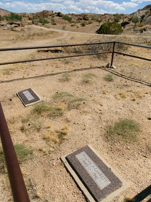 The graves of William Garrett and Arthur Coleman, the last two residents of the town, lie at the site where the mining town of Gold Butte once stood.