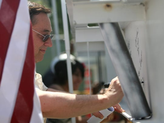 Fred Jandt signs the steel beam for the topping-out ceremony of the Health and Sciences Building at California State University San Bernardino Palm Desert campus in 2007.