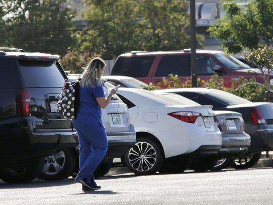 A nurse leaves Tulare Regional Medical Center. She