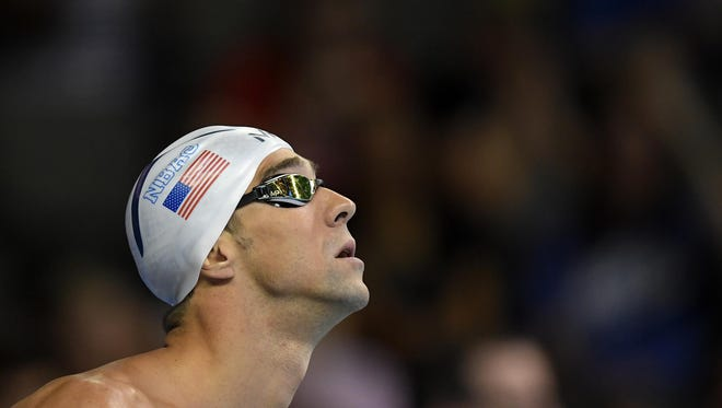 Michael Phelps waits for his heat to start in the men's 200-meter individual medley preliminaries Thursday at the U.S. Olympic swimming trials in Omaha, Neb.