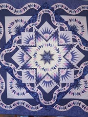 Jan Paniogue won best of show with this work during the Las Colcheras Quilt Show.