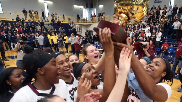 Ossining girls celebrate with the Gold Ball after defeating Lourdes 75-63 in the girls Section 1 championship game at Pace University in Pleasantville March 3, 2018.
