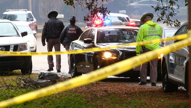 Law enforcement officers gather at the scene of the Nov. 22 officer- involved shooting on Caracus Court and Carnwath Road in Tallahassee.
