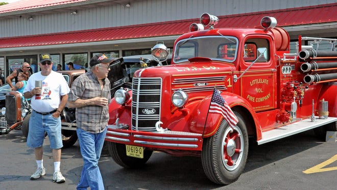 Denny Leech and Jim Brooker and their firetruck take part in Saturday's Hot Rods & Harleys car and bike show at Hartley's AutoRepair. The event benefits the family of a local 9-year-old boy named Garrett, who is in remission after battling leukemia for several years. Funds from the show and a poker run before it will help the family pay for hospital bills and expenses.
