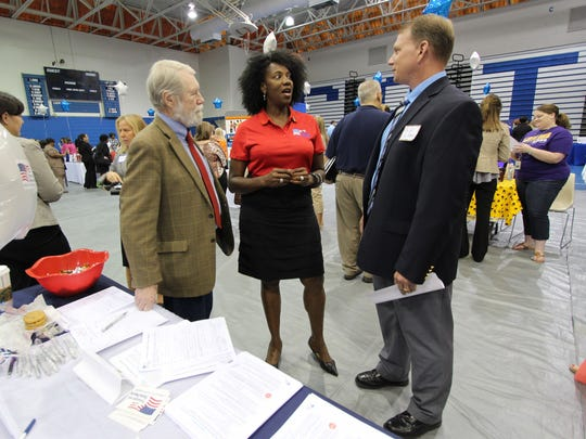 William McAleer, Chief of the Troops to Teachers Program for the Defense Activity for Non-Traditional Education Support in Pensacola, speaks to administrators during the Escambia County School District teachers' job fair Saturday at Booker T. Washington.