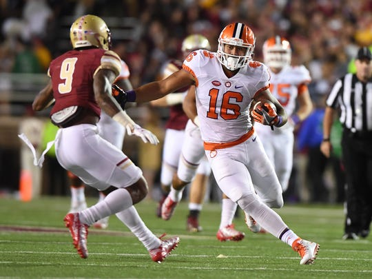 Clemson tight end Jordan Leggett (16) makes a cut past Boston College defensive back John Johnson (9) on his way to a 56 yard TD catch and run during the 1st quarter at Boston College's Alumni Stadium in Chestnut Hill, MA on Friday, October 7, 2016.