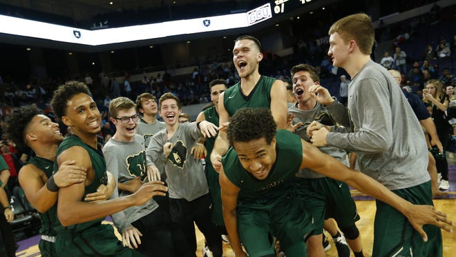 Basha players celebrate after beating Corona del Sol 75-65 during the finals of the 6A Conference state championship at GCU Arena in Phoenix, Ariz. February 28, 2017.