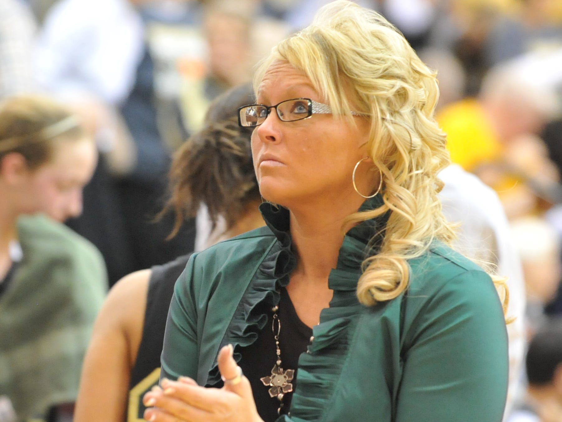 Holly Gutierrez coaches Northeastern in a 2011 game. Gutierrez was announced as Winchester's new coach Tuesday.