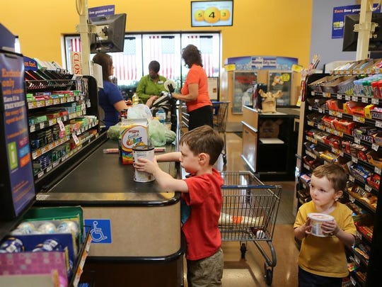 <modify__5>Kroger: $43.42 </modify__5><137>Kroger speedy June 13, 2013 Brody Fortune (cq), 4, left, and his brother Carter, 2, load groceries onto the the conveyer belt at the Kroger store in Symmes Township at Harpers Point on Thursday, June 13, 2013. Kroger has boosted check-out time at its stores with Que Vision - techonology that counts individual store traffic and determines wait times. The Enquirer/Leigh Taylor <137>
