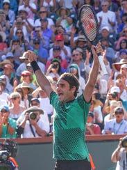 Roger Federer celebrates his win over Stan Wawrinka