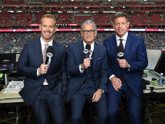 Fox Sports NFL announcers Joe Buck, Mike Pereira, and Troy Aikman in the Fox broadcast booth at Super Bowl LI at NRG Stadium on February 5, 2017 in Houston, Texas.