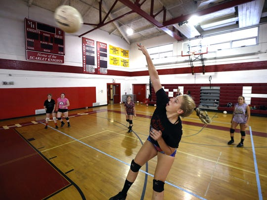 Morris Hills junior Jamie O'Shea goes for a kill during