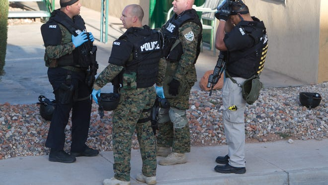 St. George Police Department SWAT team members on the scene after a 35-year-old man barricaded himself into a room at the Coronado Inn March 28, 2014 in St. George, Utah.