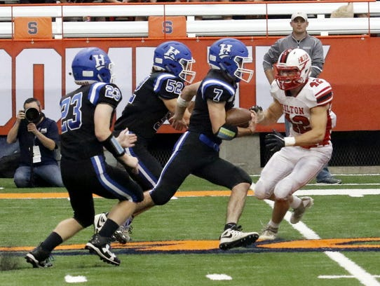 Gavin Elston carries the ball for Horseheads against