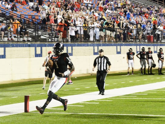 Parkway quarterback Justin Rogers scores against North