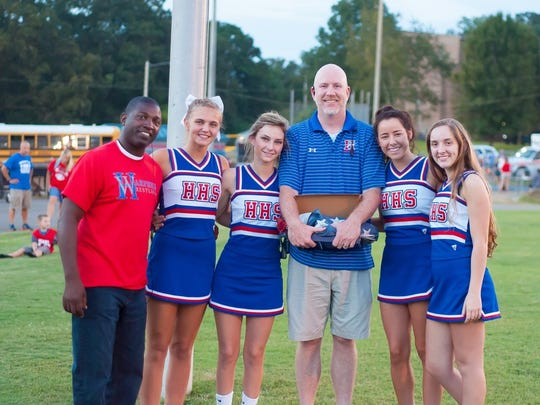Senior cheerleaders along with Coach Ricky Woods and