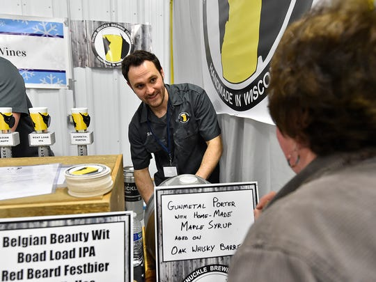 Ed Thiry of Thumb Knuckle Brewing Co. in Walhain pours Gunmetal Porter with homemade maple syrup at last year's Roar Off the Shore Brewfest.