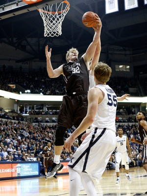 Lehigh Mountain Hawks center Tim Kempton (32) rebounds during the first half against the Xavier Musketeers guard J.P. Macura (55) at the Cintas Center.