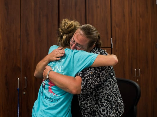 Math teacher Angela Cooper receives a big hug from one of her former students, Holly Bittner, in her classroom at Gibson Southern High School in Fort Branch. One of Bittner's younger sisters, a freshman named Nicole Bittner (not pictured), has Cooper as an Algebra I teacher for the 2017-2018 school year.