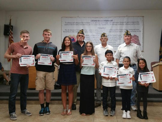 Participants in the State Americanism contest held at the Tulare Veterans Memorial Building.