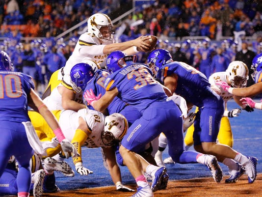 Wyoming quarterback Josh Allen (17) reaches into the end zone for a touchdown during the first half of an NCAA college football game against Boise State in Boise, Idaho, on Saturday, Oct. 21, 2017. (AP Photo/Otto Kitsinger)