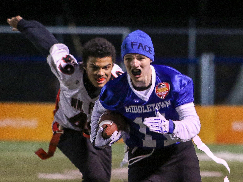Middletown athlete Dalton Johnson breaks away for a long touchdown run as William Penn athlete Nick Kane chases.
