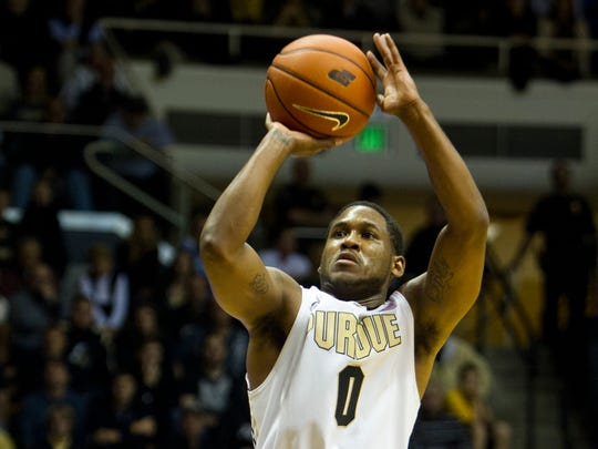 Purdue's Terone Johnson shoots over Northern Kentucky's Tyler White November 8, 2013, at Mackey Arena in West Lafayette.