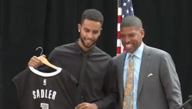 Anthony Sadler, left, holds up a Sacramento Kings jersey that was given to him by Sacramento Mayor Kevin Johnson on Wednesday, Aug. 26, 2015.