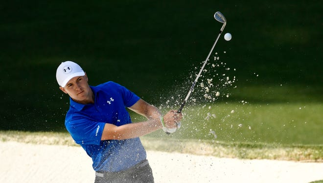 Jordan Spieth hits out of a bunker on the 10th hole during the final round of the Masters.