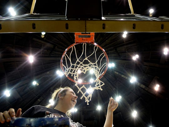 Belmont forward Maddie Wright reacts after cutting down a piece of the net after defeating Eastern Kentucky 94-64 in an NCAA college basketball game at the championship of the Ohio Valley Conference basketball tournament Saturday, March 4, 2017, in Nashville, Tenn. (AP Photo/Mark Zaleski)