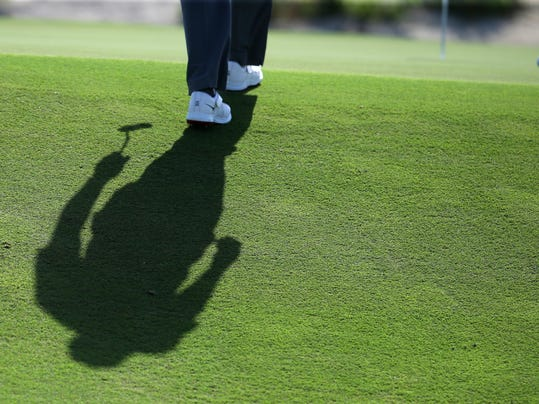 Tiger Woods walks to the seventh green during the Pro-Am at the Hero World Challenge golf tournament, Wednesday, Nov. 30, 2016, in Nassau, Bahamas. (AP Photo/Lynne Sladky)