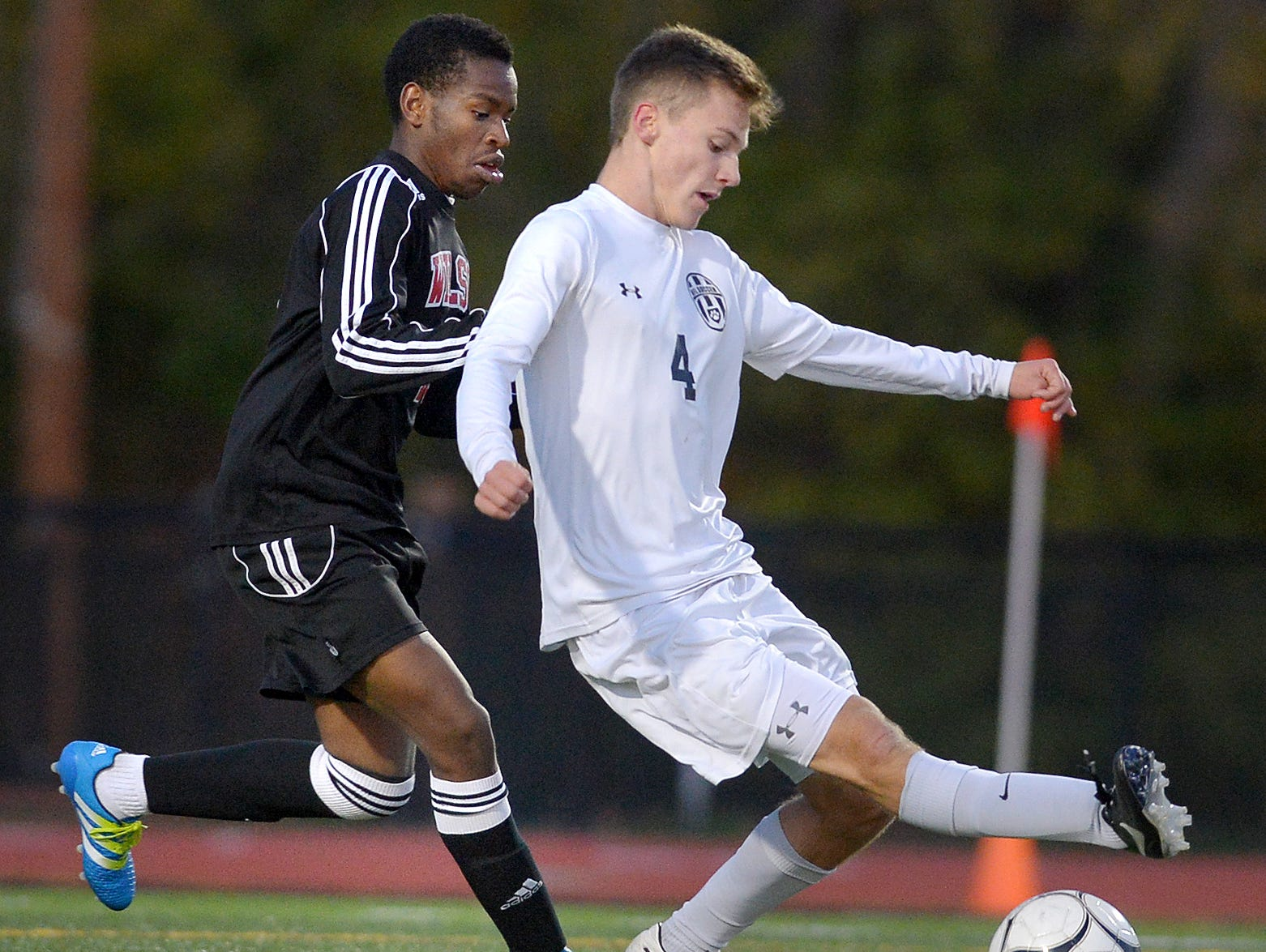 HF-L's David Goetz, right, shields the ball from Wilson's Ali Osman during the Section V Class A2 final played at Hilton High School on Oct. 28, 2016. No. 1 seed Honeoye Falls-Lima won the Class A2 title with a 4-0 win over No. 2 seed Wilson.