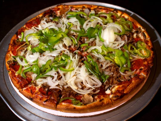 At Odyssey Pizza & Subs in Cocoa, the Odyssey Special Pizza with pepperoni, sausage, onion, green pepper, mushrooms and hamburger is a must-try dish.