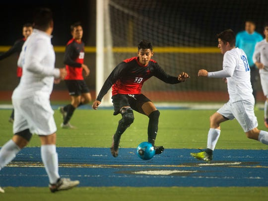 Rio Mesa's Omar Gomez (middle) takes control of possession as Fillmore's Ruben Rodriguez (right) moves in during a game earlier this season at Fillmore.