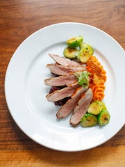 The maple-glazed duck breast was tender, with nearly