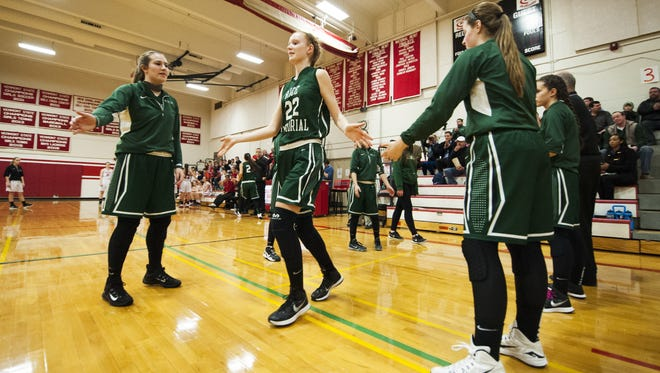 Rice's Lizzy Lyman (22) takes the court during player introductions during the girls basketball game between the Rice Green Knights and the Champlain Valley Union Redhawks at CVU High School on Monday night December 14, 2015 in Hinesburg.