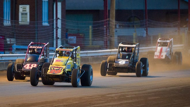 Jerry Coons Jr. (20), Tucson, Ariz., leads the field coming out of the fourth turn. Drivers competed on the mile-long track at the Indiana State Fairgrounds in the USAC Silver Crown 62nd running of the Hoosier Hundred, Thursday, May 26, 2016.