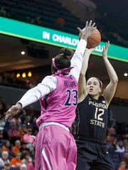 Florida State guard Brittany Brown (12) shoots over Virginia guard Aliyah Huland El (23) during the first half of an NCAA college basketball game in Charlottesville, Va., Sunday, Feb. 15, 2015. (AP Photo/Ryan M. Kelly)