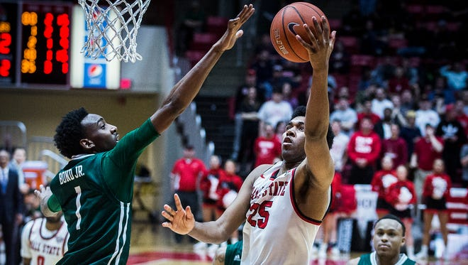Ball State's Tahjai Teague shoots past Eastern Michigan's defense during their game at Worthen Arena Tuesday, Feb. 21, 2017.
