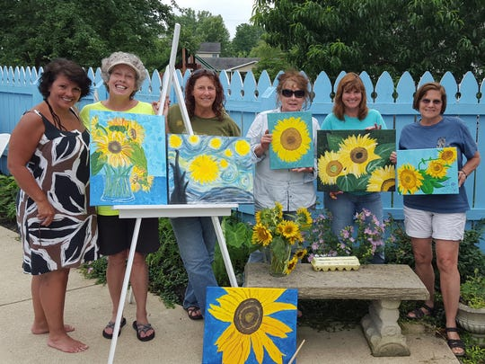 The Menopause Camp's first art project was painting sunflowers. From left to right, Debbie Zanni, Lisa Humphrey, Pam Beck, Karen Perrott, Susan Cunningham, and Nancy Robertson.