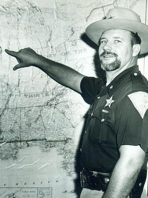 """Edward L. """"Corky"""" Cordell served as Wayne County Sheriff from 1955-1962 and as Mayor of Richmond from 1964-1967. A much-beloved public official, Corky had a great sense of humor. His contagious laughter especially rang out loud at Christmas when he dressed up as Santa Claus. This 1956 picture was taken four years prior to today's story."""