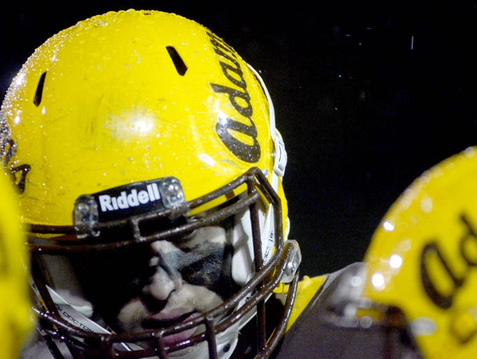 Water beads up on the helmet of a Rochester Adams helmet