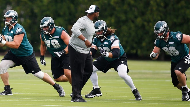 Offensive lineman (from left) Allen Barbre, Todd Herremans, Jason Kelce and Evan Mathis go through drills as the Eagles take to the practice field at the Nova Care Complex for the start of training camp, Saturday, July 26, 2014 in Philadelphia, Pa.