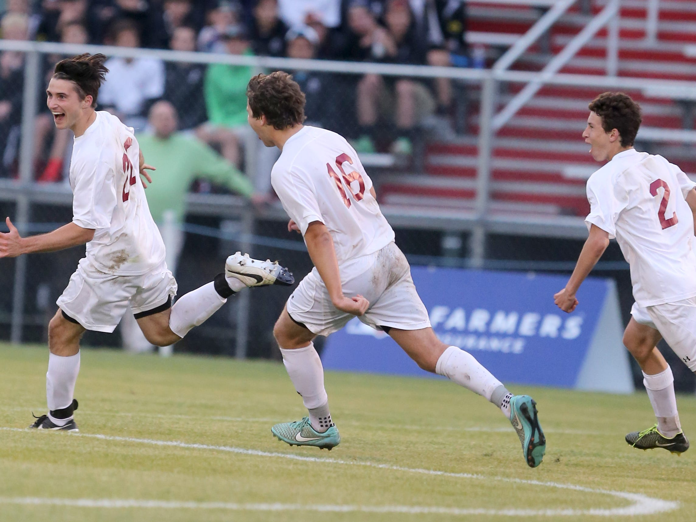 MBA's John Lafranchise (20), Christian Williams (16) and Cole Deal (2) celebrate during their Division II-AA soccer championship game win.