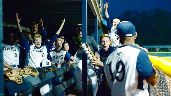 The Roberson baseball team cheers as their coach, Eric Filipek, enters the dugout following their 3-2 win over Rockingham County May 9, 2018.