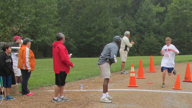 Young and old participate in the DB5K Race in Bowie Nature Park.
