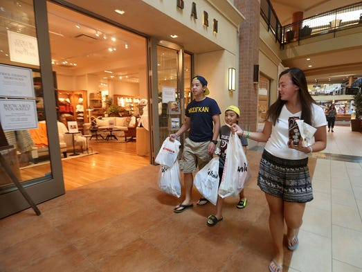 Jordan Creek Mall is celebrating its 10 year anniversary Monday, July 28, 2014. Marcus Do, 14, Jason Latta, 9 and cousing Megan Latta 13 enjoy a shopping trip Monday.