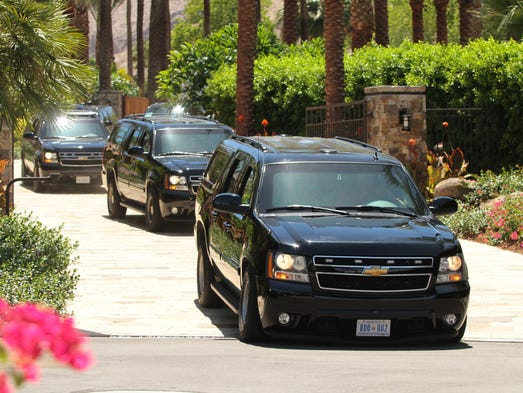 A caravan of black SUVs leaves Porcupine Creek, the golf estate owned by Oracle CEO Larry Ellison, on Sunday, June 15, 2014 in Rancho Mirage, Calif. According to pool reports, President Barack Obama spent the morning playing golf at the estate's private course with Marvin Nicholson and Joe Paulsen.